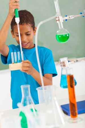 experiment: cute elementary school student in science class Stock Photo