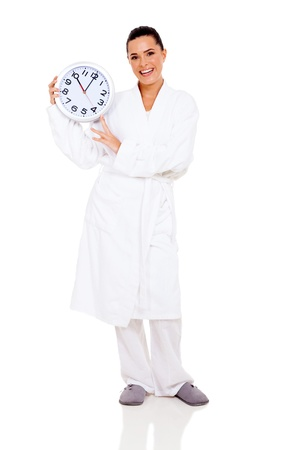 cheerful woman in bathrobe holding clock isolated on white Stock Photo - 21290951