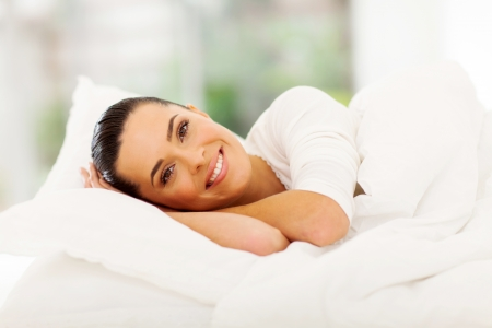 woman sleep: beautiful young woman in pajamas relaxing in bed Stock Photo