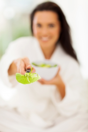 close up of woman giving fresh green salad photo