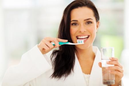 girl teeth: close up portrait of cute woman brushes her teeth