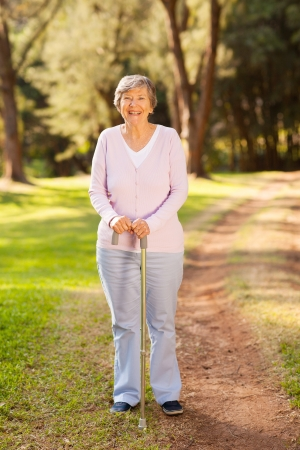 adult 80s: portrait of happy senior woman outdoors in park Stock Photo