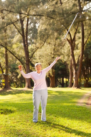 walking stick: miracle recovery concept: senior woman recovered from sickness and throwing away her walking cane