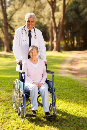 caring medical doctor and senior patient outdoors photo