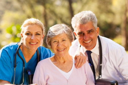 happy old man: close up portrait of healthcare workers and senior patient outdoors