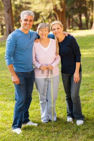 portrait of middle aged couple and mother outdoors photo
