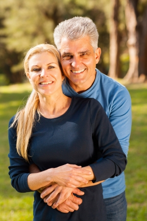 married couples: happy middle aged couple hugging outdoors Stock Photo