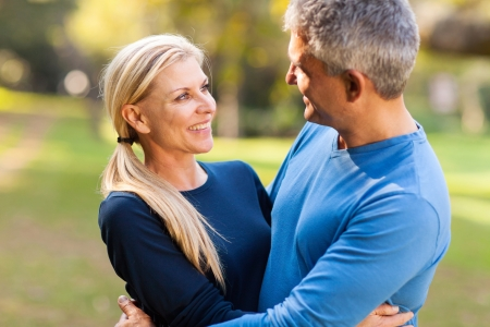 mid age: happy mid age couple embracing outdoors