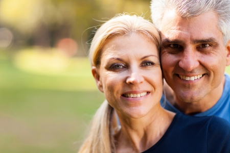 mid adult couple: elegant middle aged couple closeup portrait outdoors Stock Photo