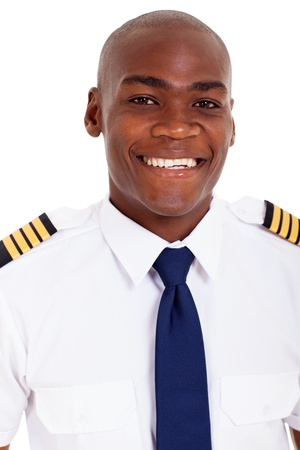 american airlines: cheerful african american pilot in uniform isolated on white