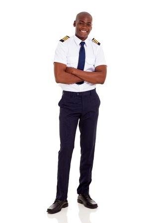 american airlines: handsome african airline captain with arms crossed isolated on white background