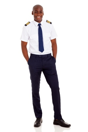 cheerful young african airline pilot standing over white background