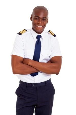 piloto: piloto africano guapo en uniforme aislado en blanco Foto de archivo