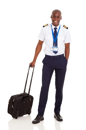 american airlines: smiling african pilot with briefcase isolated on white Stock Photo