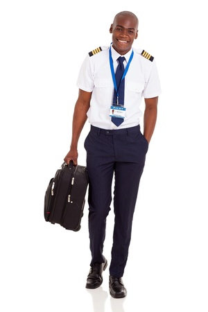 happy young airline pilot carrying briefcase isolated on white background photo