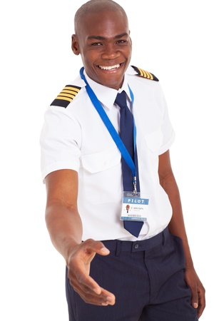 american airlines: friendly young african pilot handshake gesture isolated on white background