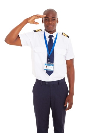 saluting: handsome airline african pilot saluting over white background