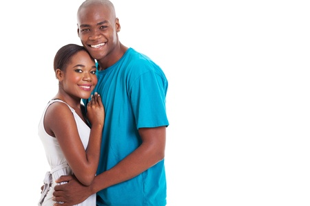 cheerful african couple hugging over white background photo