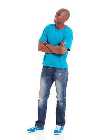 standing man: young african american man with arms folded looking away