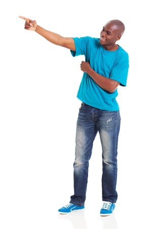 young african man pointing at copy space against white background photo