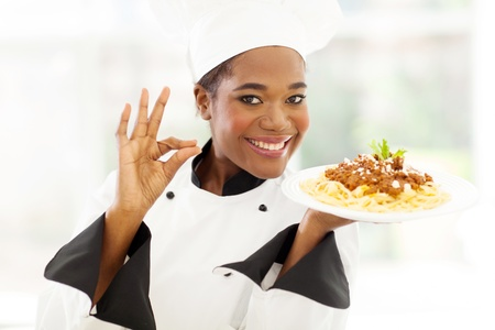 attractive young african chef with delicious pasta dish photo
