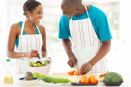 loving african husband and wife cooking dinner together photo