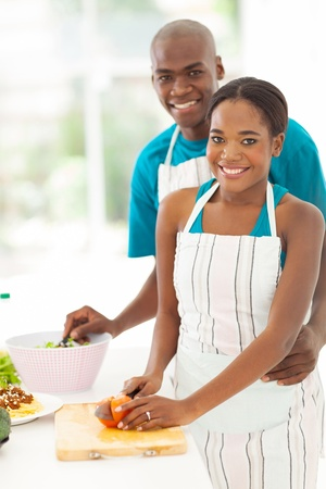 african american male: cute african american couple cooking healthy food together