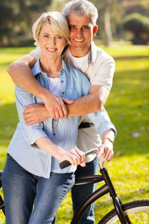 beautiful middle aged couple on bike outdoors photo
