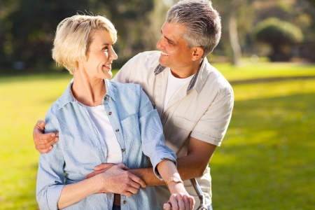 portrait of loving mature couple looking each other outdoors