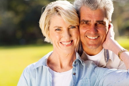 lovely mid age husband and wife portrait outdoors Stock Photo