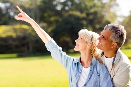 lovers park: healthy mature couple relaxing outdoors Stock Photo