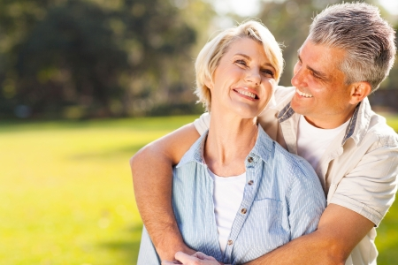 cute middle aged couple embracing outdoors  Stock Photo