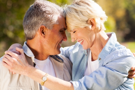 loving middle aged couple hugging with eyes closed closeup portrait photo