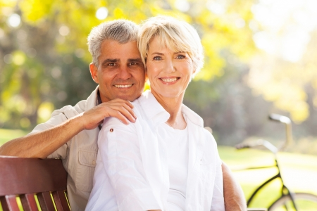 retired mature couple relaxing outdoors photo