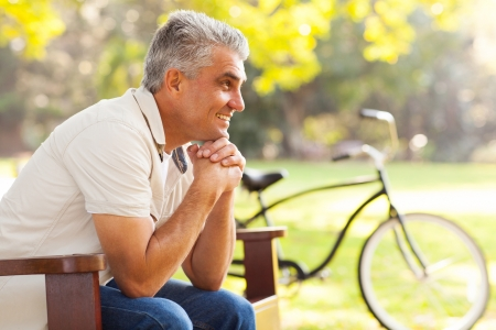 mid adult men: happy senior man relaxing at the park