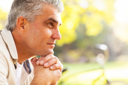 middle aged: portrait of thoughtful middle aged man outdoors