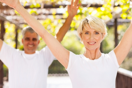 healthy senior couple working out outdoors photo
