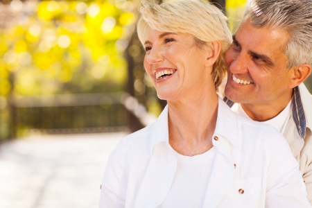 man outdoors: happy middle aged couple outdoors Stock Photo