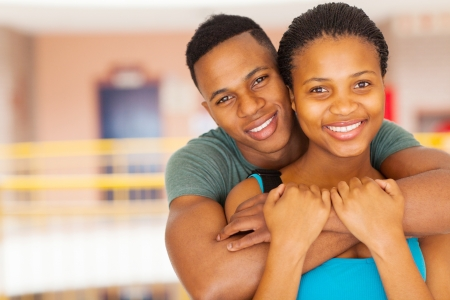 close up portrait of smiling afro american college couple photo