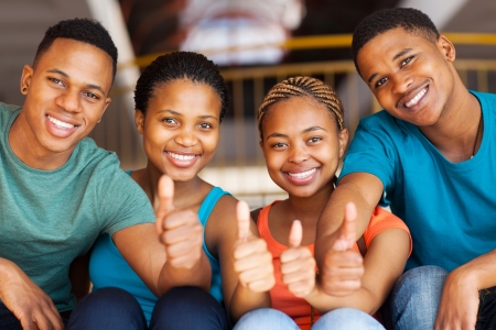 african american ethnicity: group of cheerful students wit thumbs up Stock Photo
