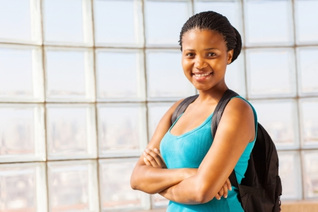confident african college student with arms folded photo
