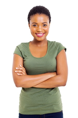 woman looking up: portrait of cute african woman with arms folded against white background
