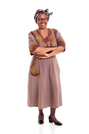 ethnic attire: cheerful senior african woman with arms crossed over white background Stock Photo