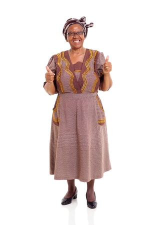 elderly african woman giving thumbs up on white background photo