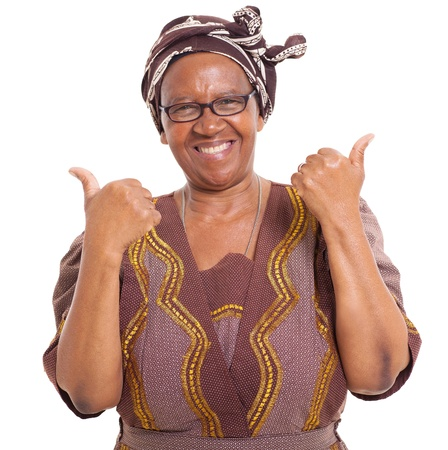 ethnic attire: senior african woman giving two thumbs up as sign of approval Stock Photo