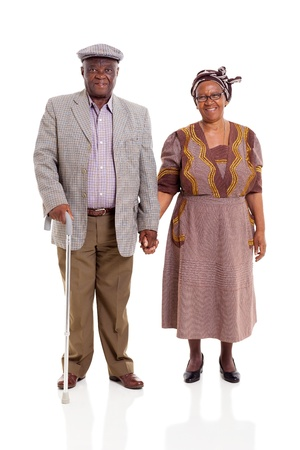 cutout old people: senior african couple holding hands on white background Stock Photo