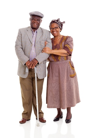 smiling elderly africam couple standing on white background