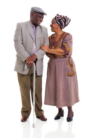 to another: loving senior african couple looking one another over white background Stock Photo