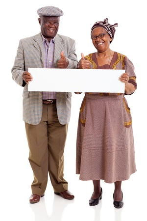 cheerful elderly african couple holding blank banner giving thumbs up photo
