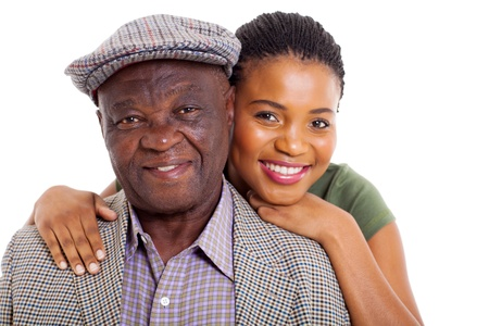 close up portrait of african daughter and senior father on white background photo